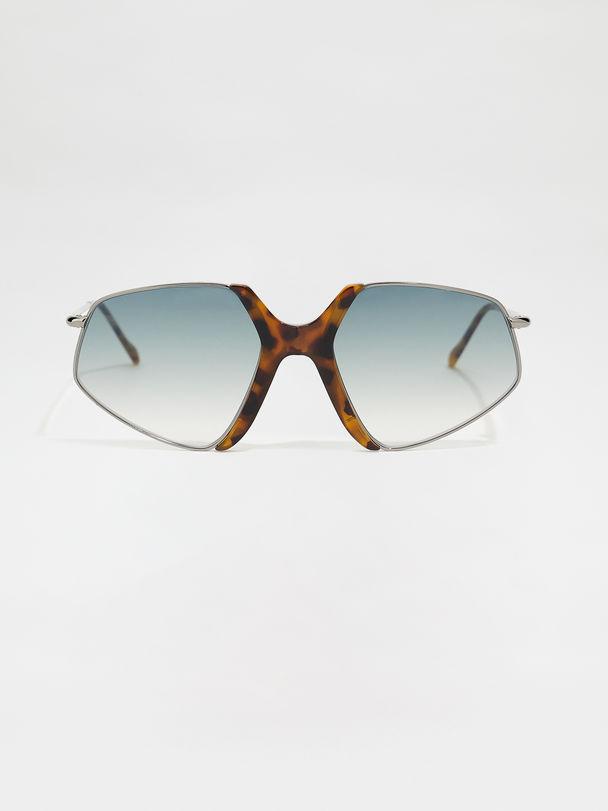 Acetate and metal glasses